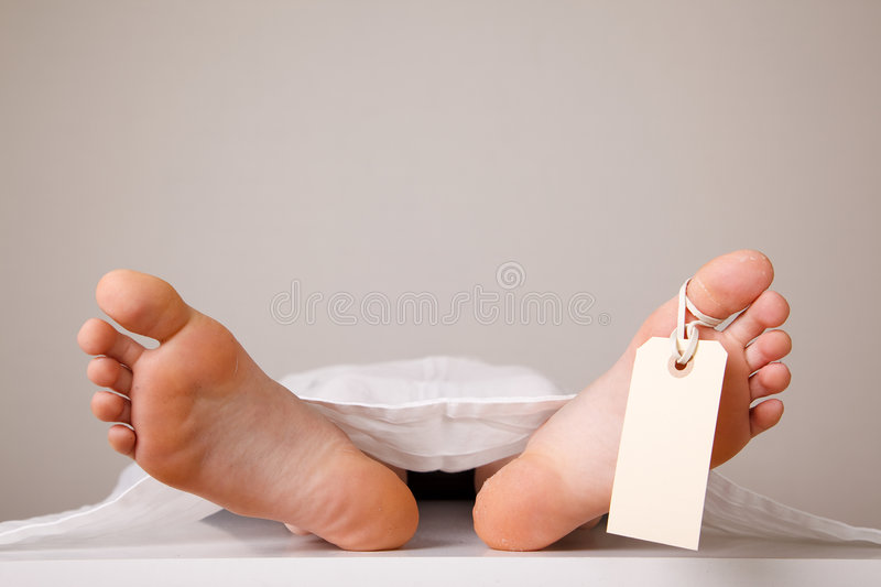 Two feet of a dead body royalty free stock photography