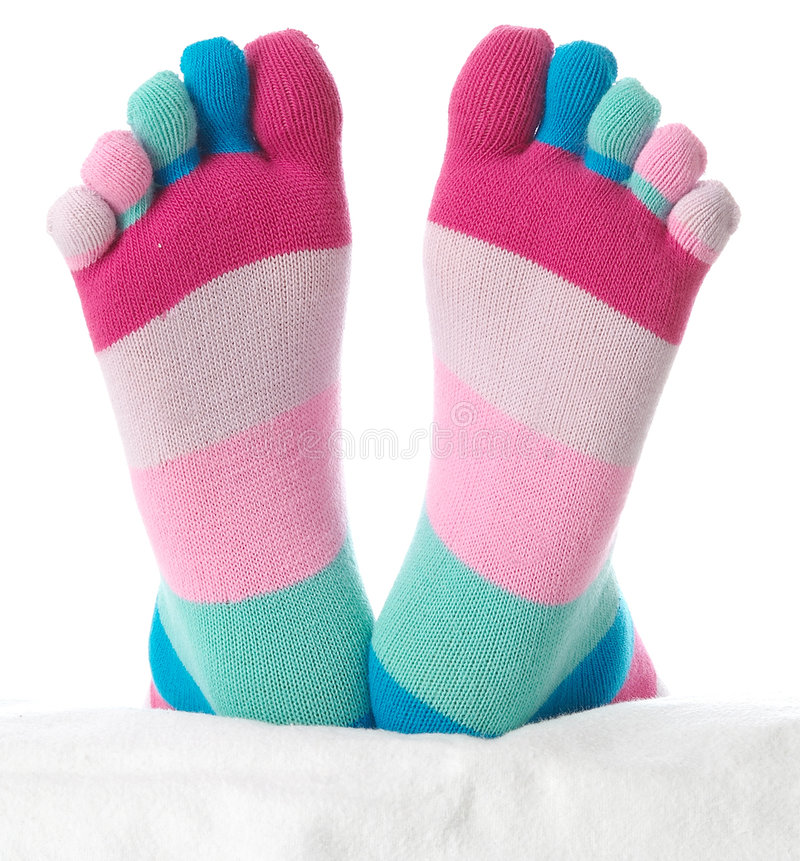Two feet in stockings royalty free stock photos