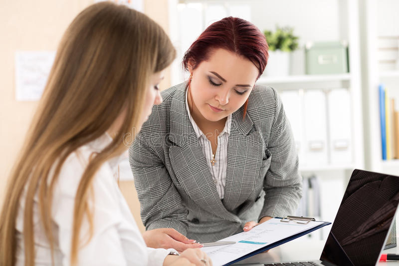 Two female auditors looking at financial report royalty free stock photos