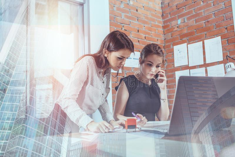 Two female colleagues in office working together. royalty free stock images