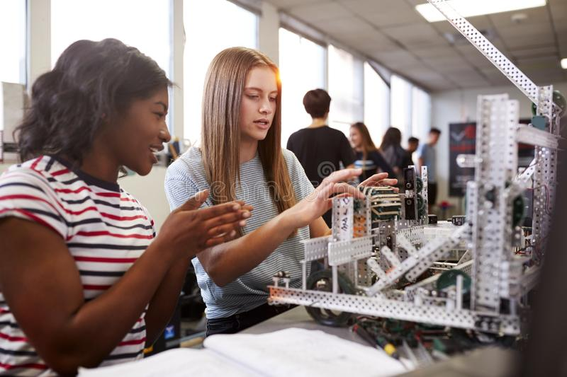 Two Female College Students Building Machine In Science Robotics Or Engineering Class royalty free stock photography