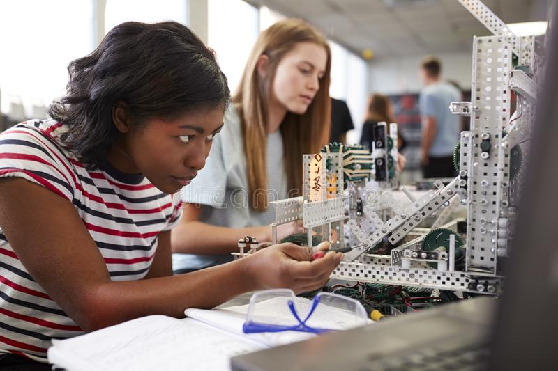 Two Female College Students Building Machine In Science Robotics Or Engineering Class stock photography