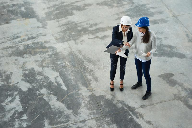 Two Female Engineers at Factory royalty free stock image