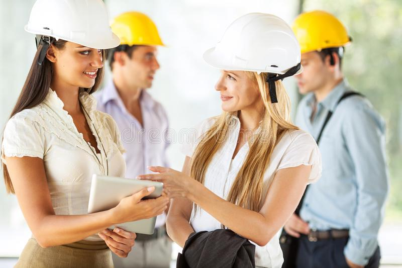 Two female engineers visit the construction site. stock photo