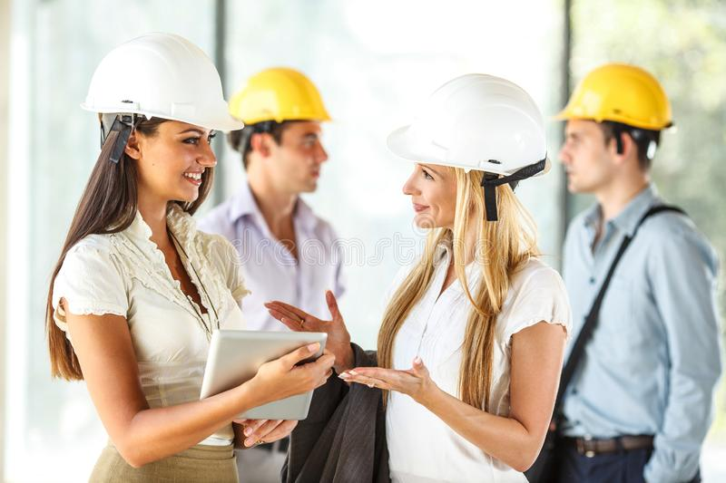 Two female engineers visit the construction site. royalty free stock photos