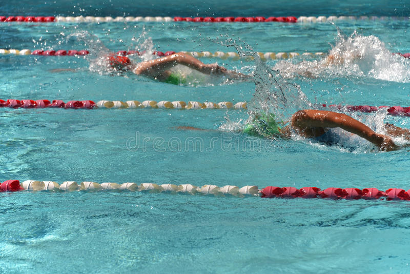 Two female freestyle swimmers stock photos