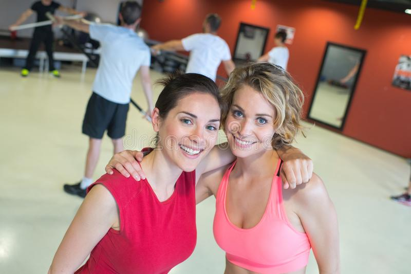 Two female friends at gym stock photos