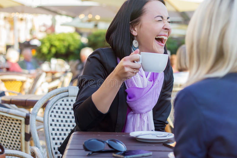 Two female friends having good time together stock images