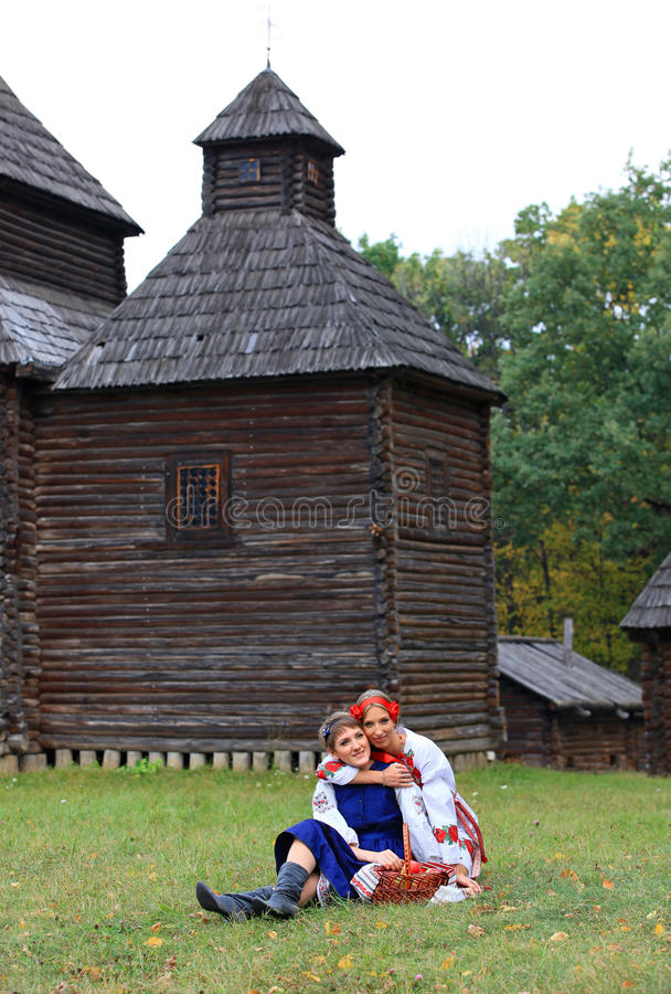 Two female friends in Ukrainian costumes stock image
