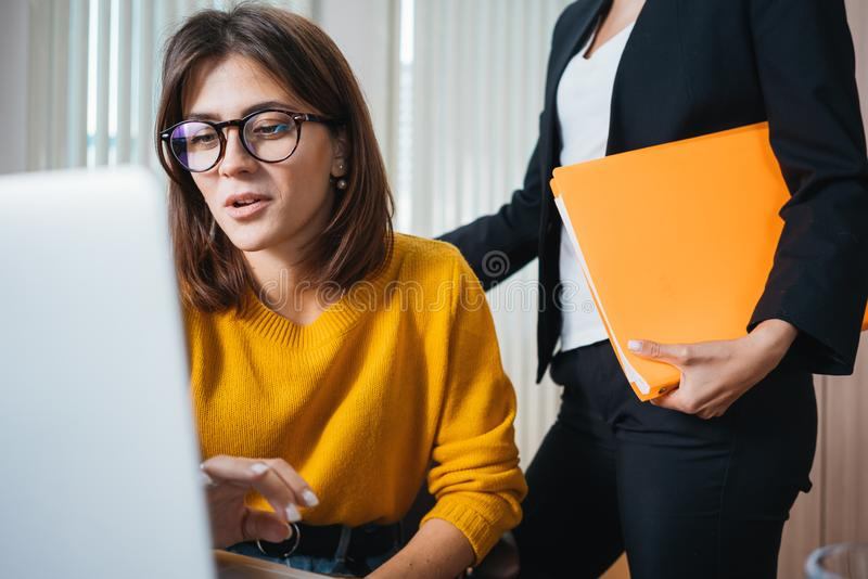 Two female manager using laptop at workplace at office royalty free stock photography