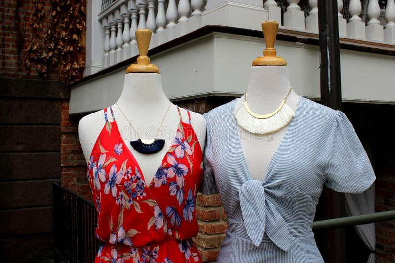 Two mannequins dressed in fashionable clothes for warmer weather, Downtown Saratoga Springs, New York, 2018 stock photo