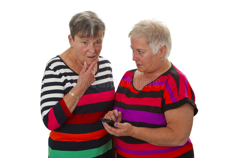 Two female senior with cellphone royalty free stock photo