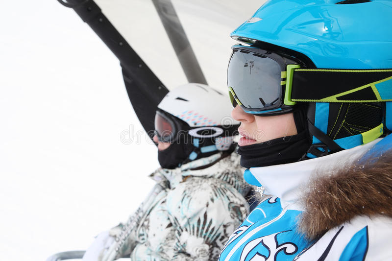 Two female skiers ride on funicular royalty free stock photo