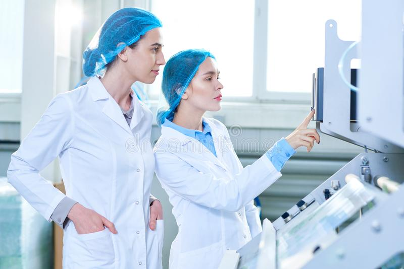Two Female Specialists at Factory royalty free stock photo