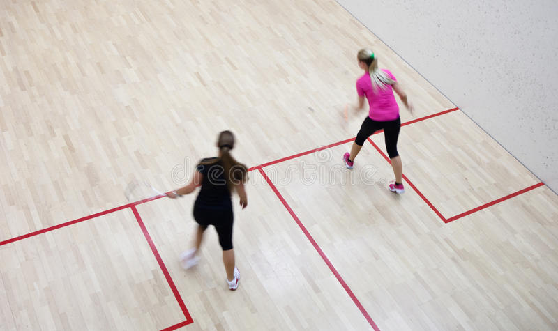 Two female squash players stock photography