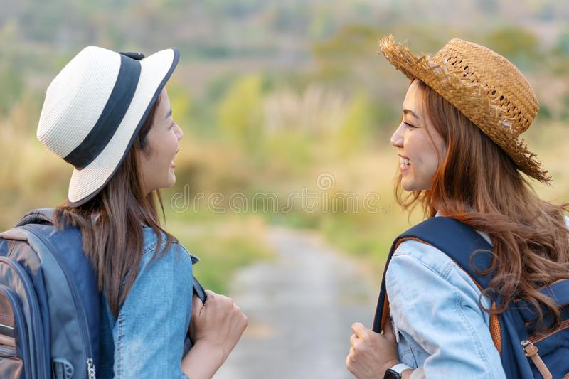 Two female tourist with backpack in countryside. Two female tourist with backpack in the countryside royalty free stock image
