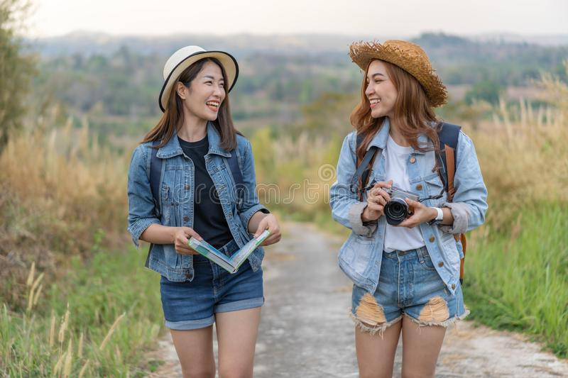 Two female tourist with backpack in countryside. Two female tourist with backpack in the countryside royalty free stock photos