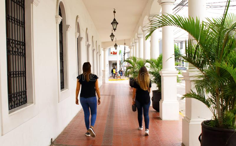 Two female tourists walking in Santa Cruz de la Sierra, Bolivia. City center at day royalty free stock photography