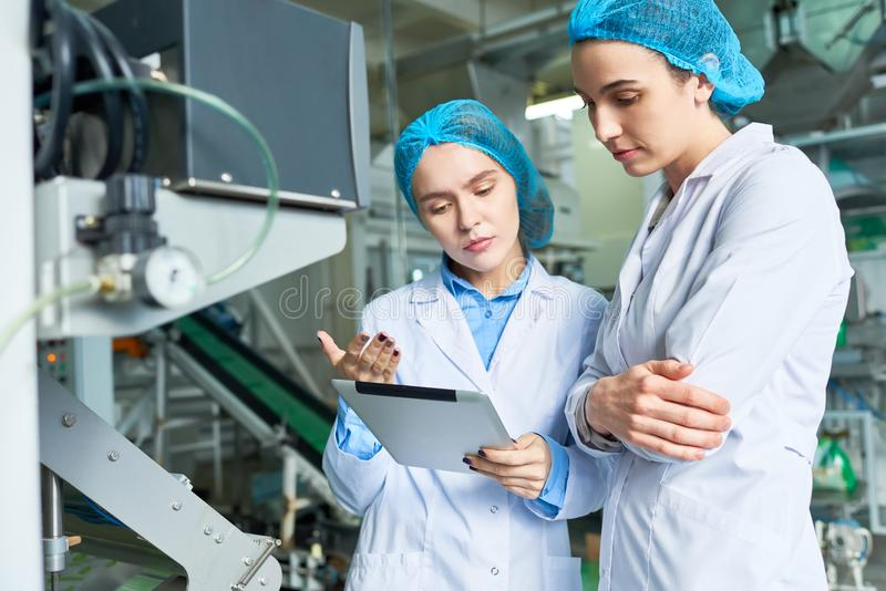 Two Female Workers at Factory royalty free stock photo