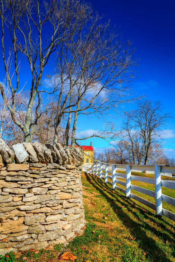 Two fences. Traditional stone and wooden fences in Shaker Village of Pleasant Hill, Kentucky royalty free stock photography