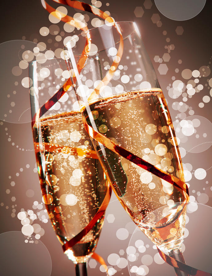 Free Two Festive Glasses Of Bubbly Champagne Stock Photo - 61004860