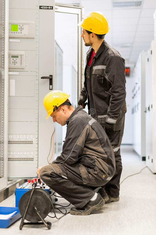 Field service engineers inspect system with relay test set equip royalty free stock images