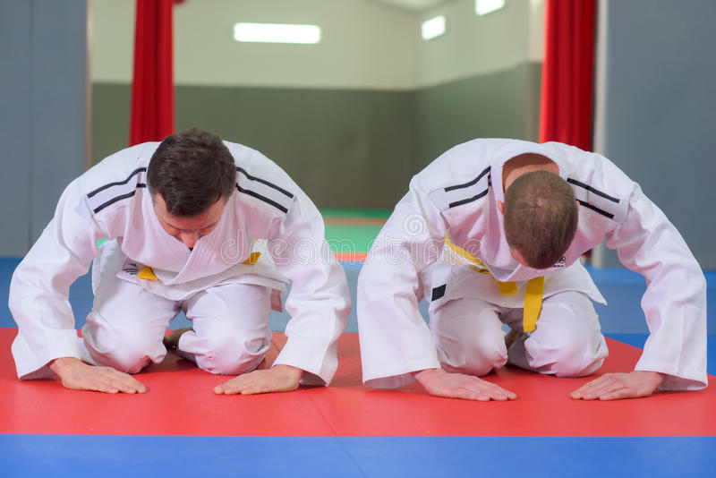 Two fighters bowing before fight. Two fighters bowing before a fight stock photography