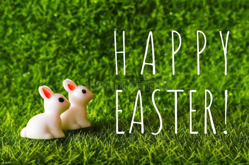 Two figures Bunny on the grass. Happy Easter concept stock photography