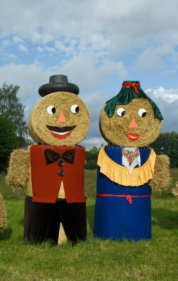 Download Two Figures Made Out Of Straw Bales Stock Photo - Image: 27099228