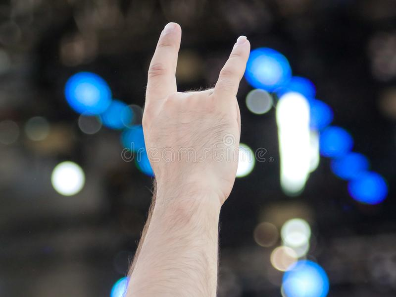 Two fingers on the hand at the concert stock image