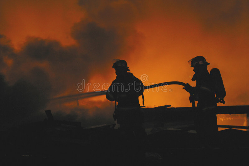 Two firefighters royalty free stock image