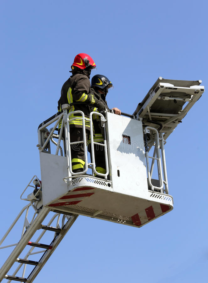 Download Two Firefighters In The Cage Of Fire Engine Stock Photo - Image of firefighter, engine: 55757440
