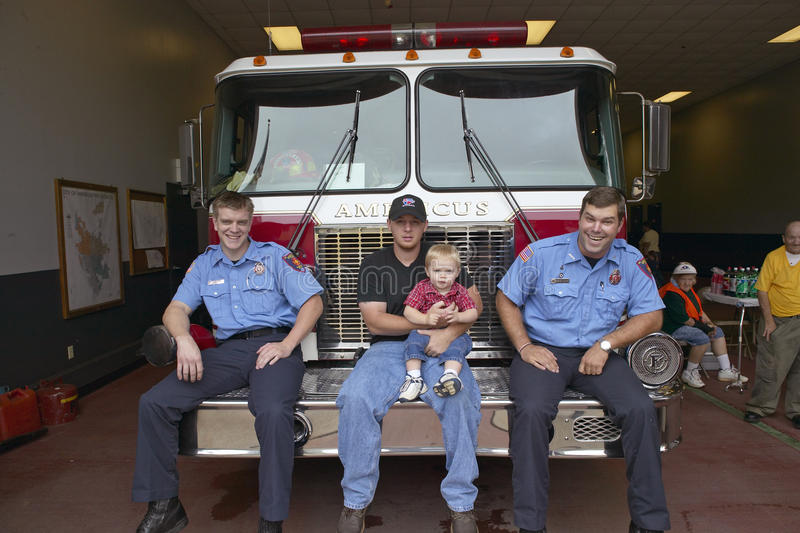 Download Two Firemen, Father And Son Editorial Photography - Image: 26273612
