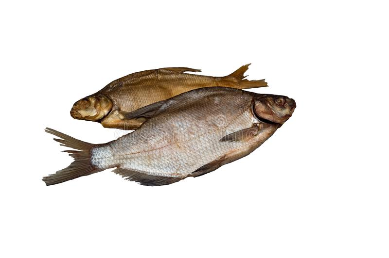 Two fish bream, one dried salted, the other salted, cold smoked. royalty free stock images
