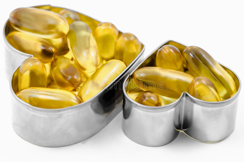 Two Fish Oil in Heart shape boxes isolated royalty free stock photos