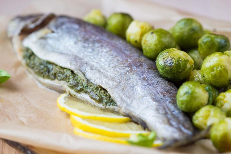 Two fish, rainbow trout stuffed with green herb sauce royalty free stock image