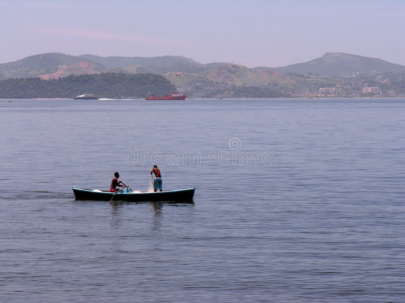 Two fishermen in boat stock photos
