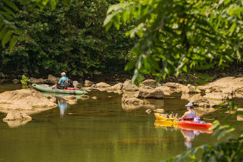 Two Fishermen Fishing For Smallmouth Bass. Roanoke County, VA – June 11th: Two fishermen in kayaks fishing for smallmouth bass on the Roanoke River next stock photography