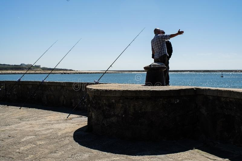Porto, Portugal - April 5, 2017: Fishermen in Foz do Douro stock images