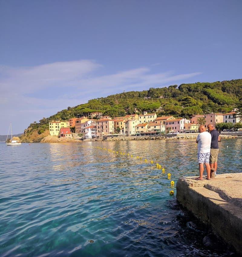 Two fishermen on the pier, marina Marina Marina stock images