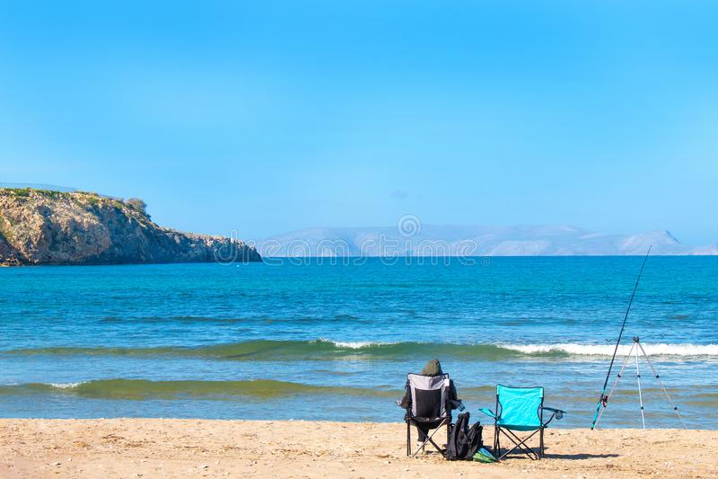 Two fishing chairs on the beach. Fishing on the beach, Mediterranean sea royalty free stock images