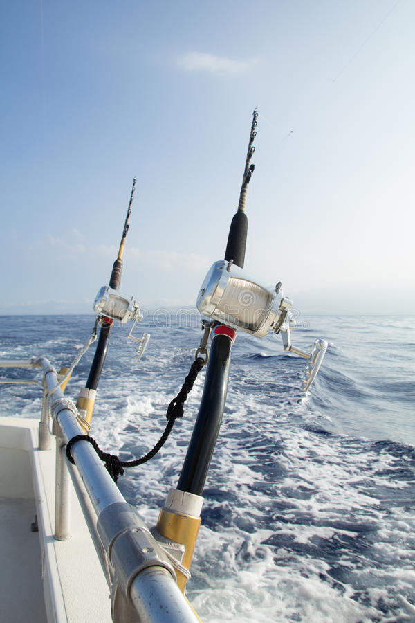 Free Two Fishing Rigs Tethered To Rail Stock Photo - 99020890