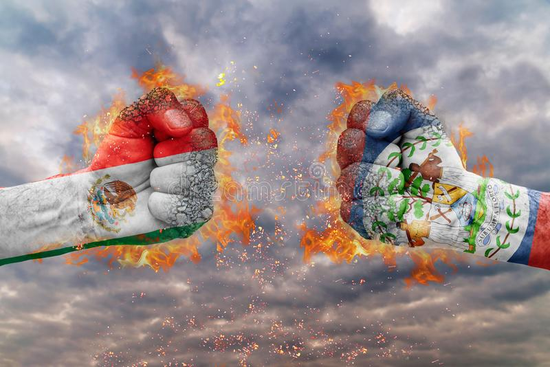 Two fist with the flag of Mexico and Belize faced at each other. Ready for fight royalty free stock images