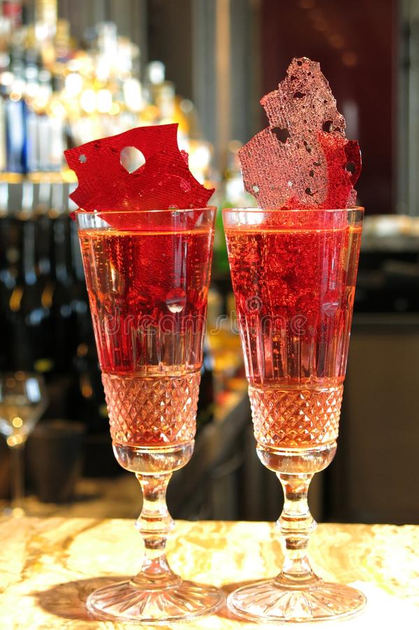 Free Two Fizzy Red Cocktails In Champagne Flutes On A Bar Royalty Free Stock Photo - 78253075