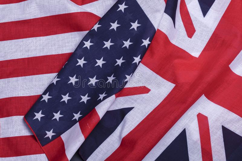Two flags American and British. Two flags English union jack and USA star spangled banner. Material symbols of first world countries royalty free stock photos