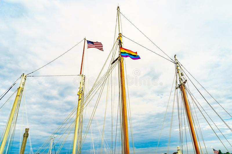 Two flags on yachts masts in Provincetown& x27; marina, Massachusetts stock image