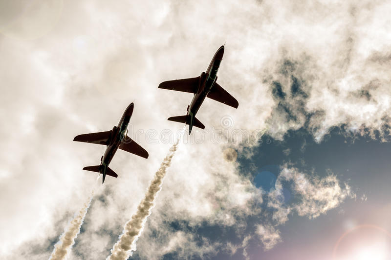 Two flying fighter jets in the sky stock images