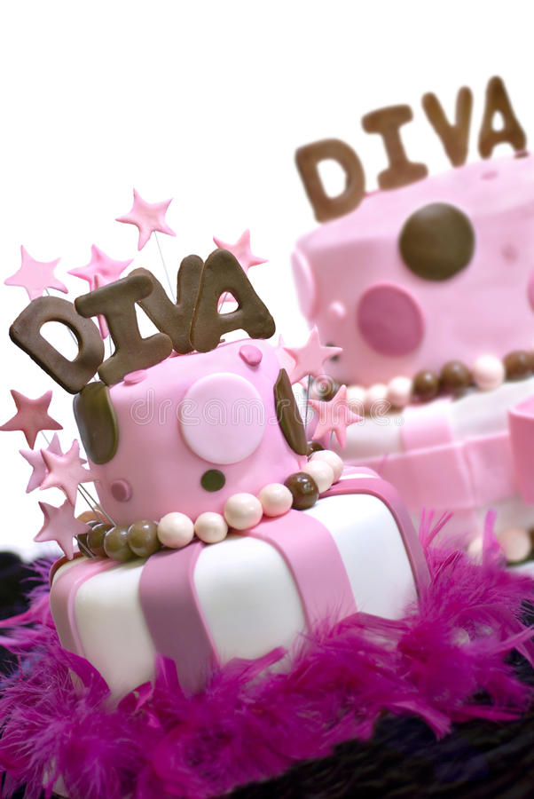 Two Fondant Cakes. Two pink fondant cakes with Diva spelled out on top and stars garnishing the front cake. Front cake is in focus, rear cake out of the depth of royalty free stock photography