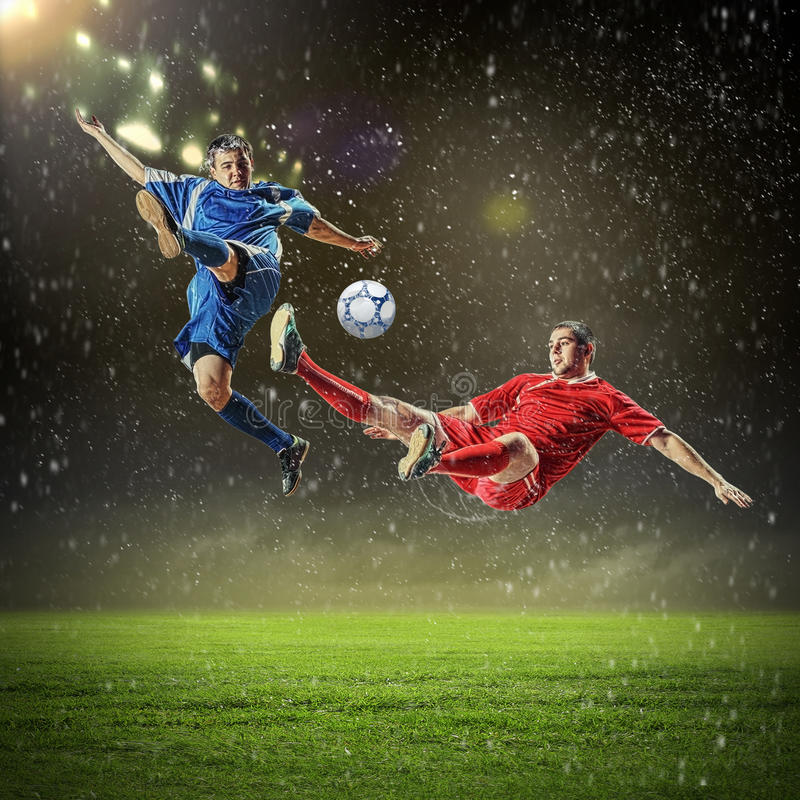 Free Two Football Players Striking The Ball Stock Photo - 29511450