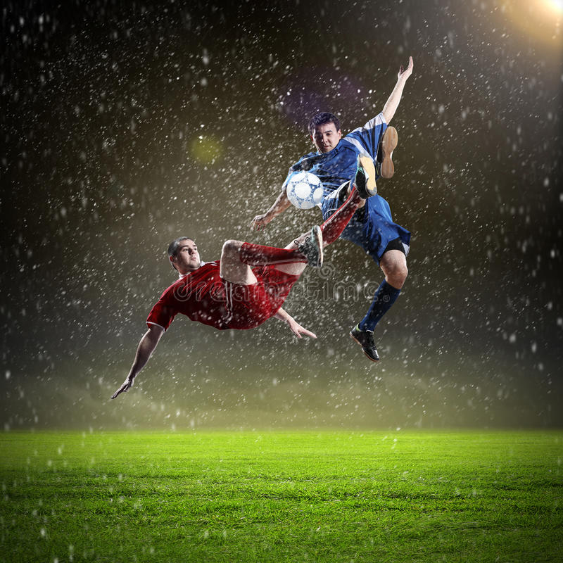 Free Two Football Players Striking The Ball Stock Images - 29794864